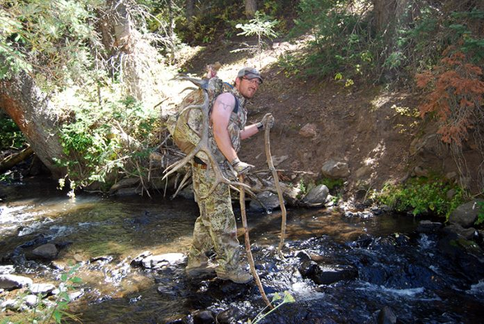 Darin Cooper crossing a creek