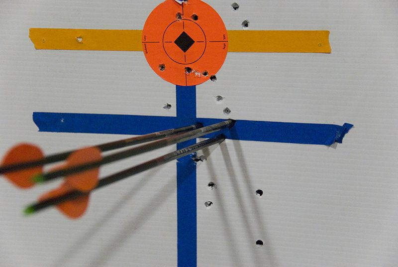 3 arrows in a target showing the trick pin system